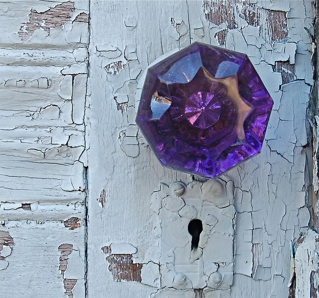 Oh, my!  I love, love, LOVE this sun-purple doorknob and the chipped blue paint behind it.