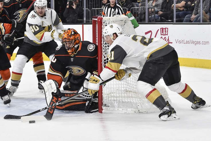 Cody Eakin #21 of the Vegas Golden Knights handles the puck while Ryan Miller #30 of the Anaheim Ducks defends his goal during the game at T-Mobile Arena on February 19, 2018 in Las Vegas, Nevada.