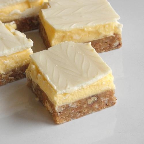 Blonde Nanaimo Bars ~ uses the traditional Bird's custard power in filling, graham cracker, coconut, pecan crust. Sweet
