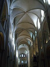 The sexpartite ribbed vault at St Etienne, Caen-  The characteristic forms that were to define Gothic architecture grew out of Romanesque architecture & developed at several different geographic locations, as the result of different influences & structural requirements. While barrel vaults & groin vaults are typical of Romanesque architecture, ribbed vaults were used in the naves of two Romanesque churches in Caen, Abbey of Saint-Étienne and Abbaye aux Dames in 1120.