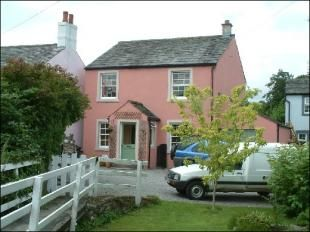 Cute little pink cottage.