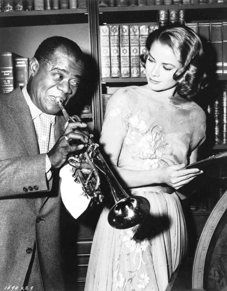 Grace Kelly and Louis Armstrong on the set of High Society.