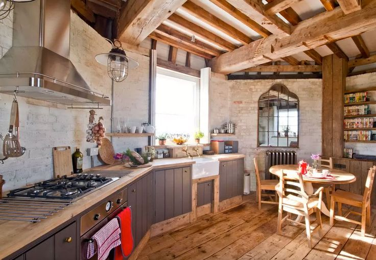 Old Smock Windmill in Kent via Airbnb | Rustic wood cottage meets modern | Check out www.StainlessSteelTile.com for more kitchen design ideas