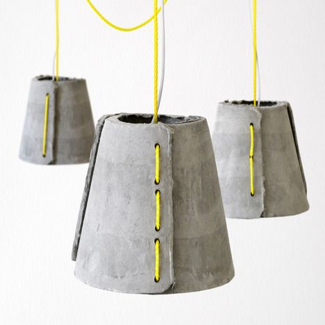 –From Rainer Mutsch, a pendant light for outdoor usage consisting of three hand molded fiber-cement shells and sailing rope.