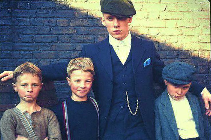 Young actor Alfie, far right, on the set of Peaky Blinders with actor Joe Cole, …
