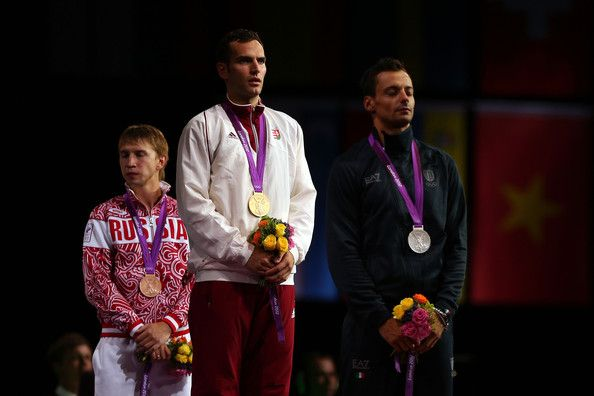 (R-L) Silver medalist Diego Occhiuzzi of Italy, gold medalist Aron Szilagyi of Hungary and bronze medalist Nikolay Kovalev of Russia pose on the podium during the medal ceremony for the Men's Sabre Individual on Day 2 of the London 2012 Olympic Games at ExCeL on July 29, 2012 in London, England.