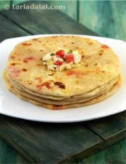 A great combination of paneer, cheese and chillies stuffed in a paratha. . .