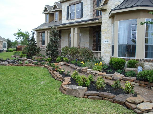 Front yard landscape with double stack moss rock and for Landscaping rocks corpus christi