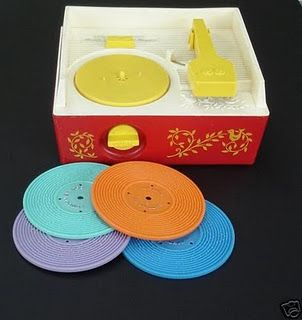 Fisher Price record player- what my baby brother, Andy brought home from the hospital to me (I was 3.5) after he was born.  I remember it like it was yesterday!  It's really been 34 years in July!!  Ghah!