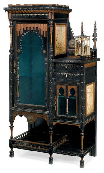CARLO BUGATTI (1856-1940)  CABINET, circa 1900, polished, stained and ebonised walnut, inlaid with pewter and copper, hand-painted vellum panels depicting cranes and aquatic plants, applied silk tassles, the doors with textured glazed panels, bronze handle cast as a lizard, 69¾ in. (177 cm.) high; 35½ in. (90 cm.) wide   |  SOLD $53,634 Christie's London, April 21, 2010