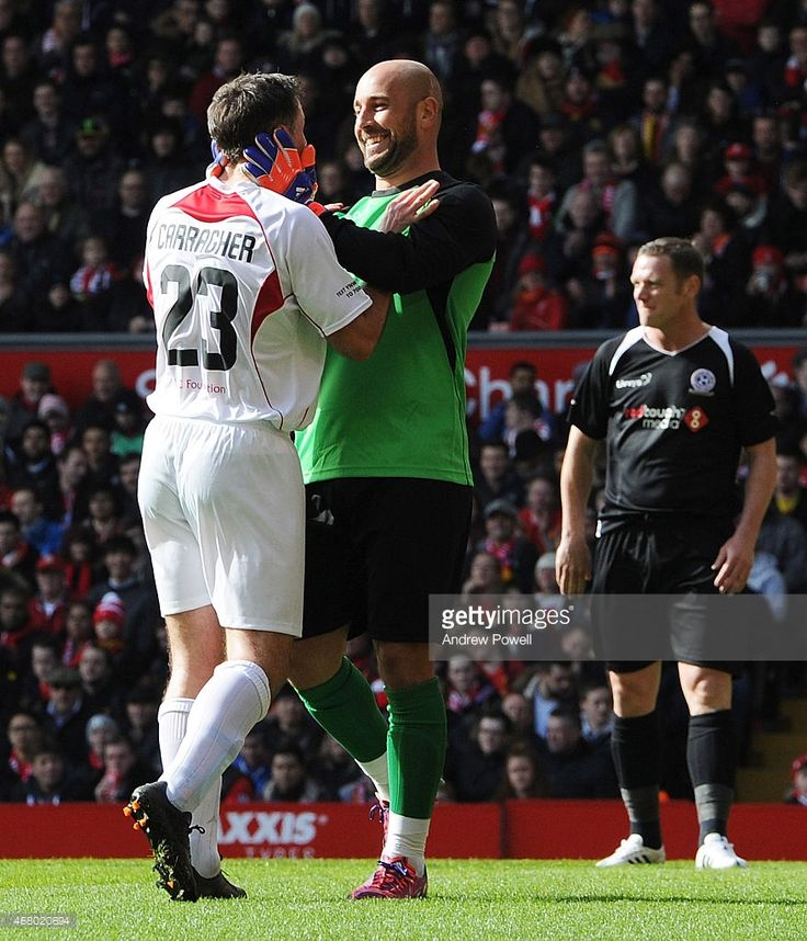 Jamie Carragher and Pepe Reina share a moment during the Liverpool All Star Charity Match at...