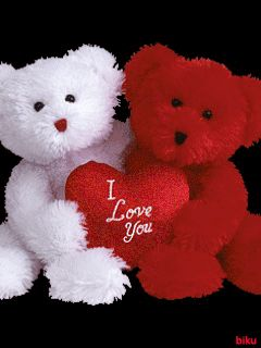 "A WHITE AND RED BEAR SHARE ONE HEART THAT READS "" I Love You "" ON IT. THEY ALSO GLISTEN AND MOVE THEIR NOSES.."