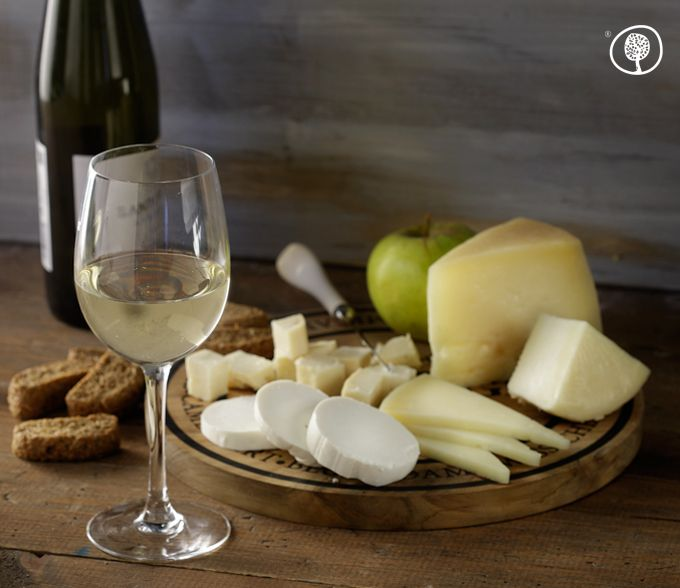 Out on the patio with friends on a summer evening? Enjoy a plate of Greek cheese accompanied by white wine! At www.yolenis.com you will find a fine selection of wines and PDO Greek cheeses. #wine #cheese #greek #summer #summernight #dinner #romantic #friends