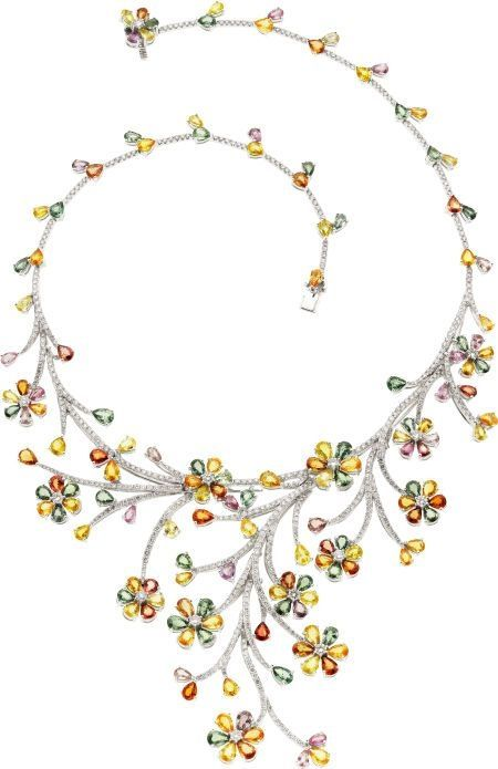 Sapphire, Diamond, White Gold Necklace  The necklace features pear-shaped green, yellow, orange, pink and purple sapphires weighing a total of 50.58 carats, enhanced by full-cut diamonds weighing a total of 8.24 carats, set in 18k white gold.