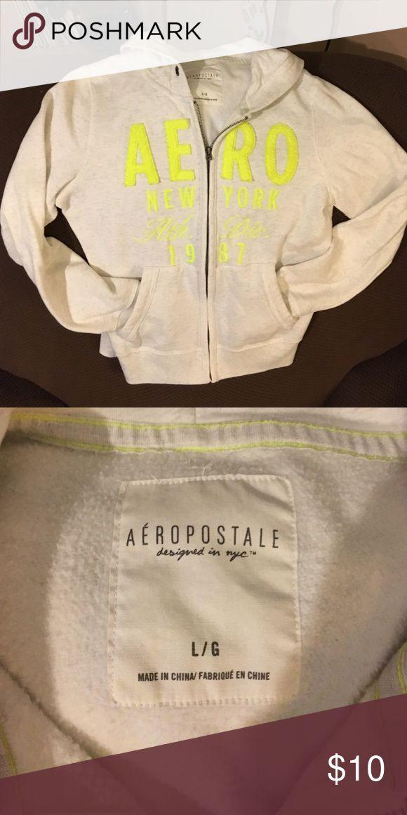 Aeropostale zip up jacket w/ hood GUC. Cream jacket w/ neon green lettering. Zip up jacket w/ hood. Size Large Aeropostale Tops Sweatshirts & Hoodies