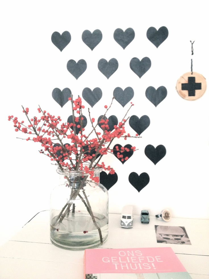 Hearts on the wall and spring flowers