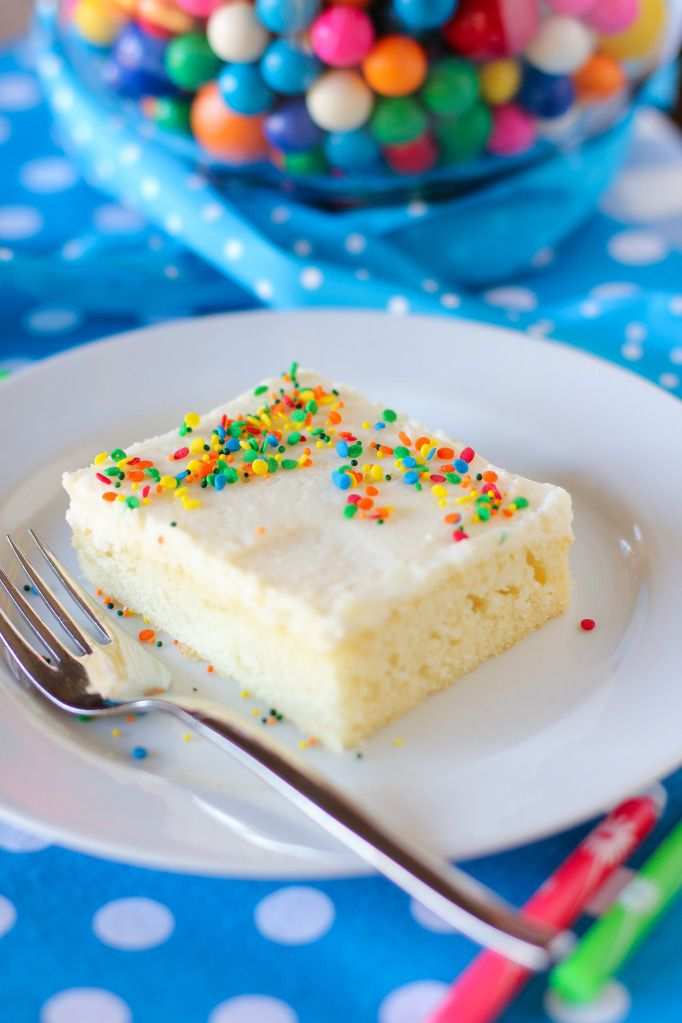 White Sheet Cake with Fluffy Whipped Icing. Uses 1/2 cup sour cream and fluffy icing has heavy cream.