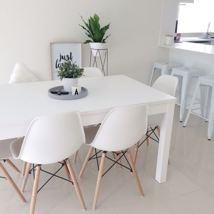 Dining room. Eames, white, green, minimal.                                                                                                                                                                                 More