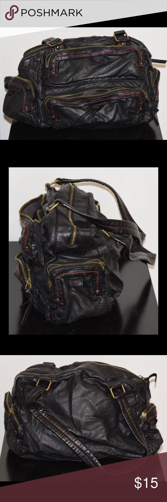 """Converse Black Faux Leather Purse Stylish with storage! Soft faux leather slouchy black handbag with zippered pockets. Zippered inside pocket, with roomy zippered pockets on front and sides. Red stitching. Like new. Approx 12"""" L, 9"""" H Converse Bags Satchels"""