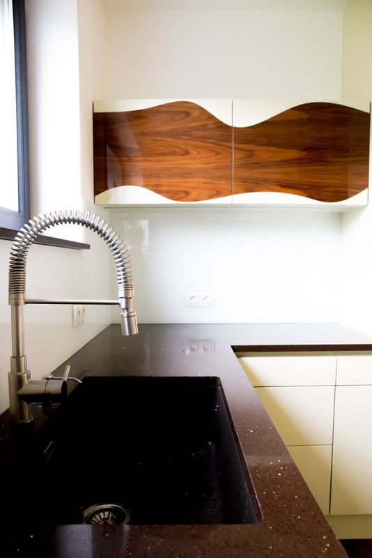 Wave across all kitchen top cabinets and shelving makes the space dancing. Bespoke kitchen by Roman Bursicek www.rb-t.cz, finished in off white high gloss MDF cabinets with veneered walnut wave.