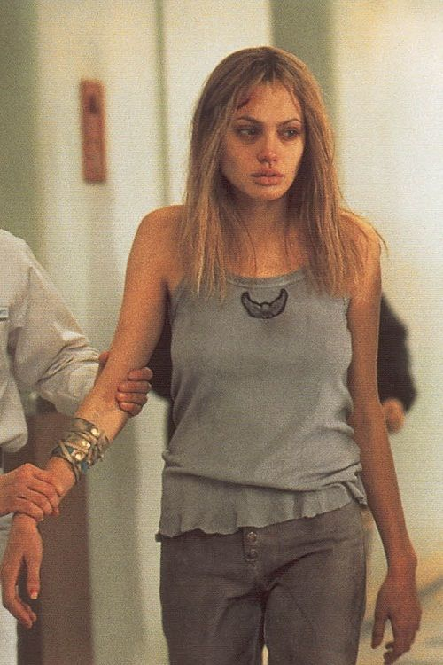 Angelina Jolie - Girl Interrupted....she is such an amazing actor that even in still shot, she convinces you. Whoa, this proves she can act. I tried to see that movie but I couldn't. I had to walk out. But I hear both Angelina & Winona Rider did an amazing, Oscar worthy job -Mari