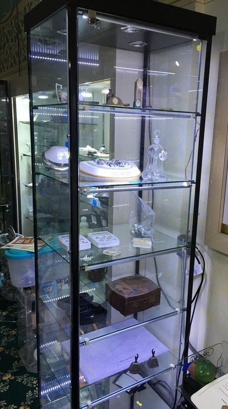 "Professional glass jewelry cabinet. Upgraded with LED lighting. Measures, 23"" x 18"" x 75"". Having working key. Contents of Rose Garden Jewelers in Mount Kisco."