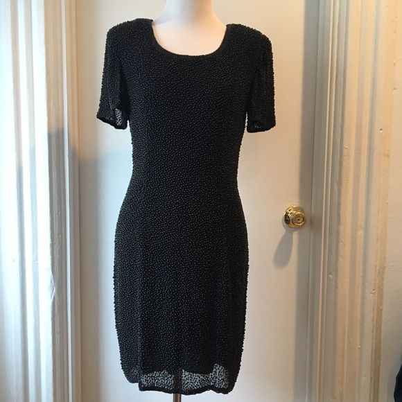 Vintage beaded black dress Neiman Marcus LBD Vintage beaded black dress that is perfect for holidays or cocktail hour! From Neiman Marcus in the late 90s. Features slight shoulder pads and is fully lined. Silk outer layer with beading, rayon lining. Back zip. Scoopneck. Short sleeve. LBD  Fits true to size (4) or a small.  35 inches long. 17 inches across chest. 14 inches across waist. 18 inches across hips. Excellent condition. Oleg Cassini Dresses