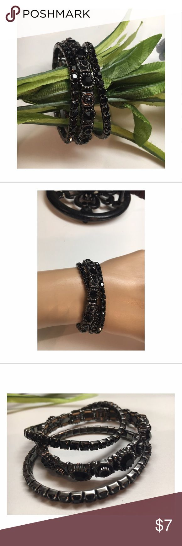 Black Rhinestone Sparkly Bracelets This is a pretty set of three bracelets in black polished resin rhinestones.                                All stones in tact. Stretches onto wrist. Never worn. New! Jewelry Bracelets