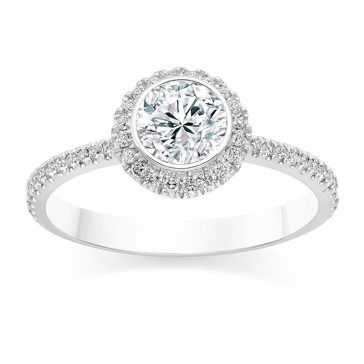 Africn - Diamonds - Platinum  The Halo Ring Setting  The Halo Engagement ring made its debut in the 1920s  Apart from giving you great options to personalize and customize your engagement ring, the halo setting is mostly used to accentuate the size of the centre stone.  The halo ring setting encircles a centre gemstone in a collection of pave or micro-pave diamonds.  Visit our site : www.africn.com to see more ring settings  #diamonds #africn #engagement