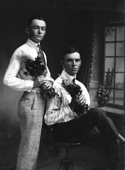 Young men holding flowers, Texas, early 1900s