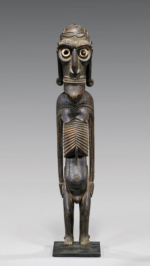 "ANTIQUE EASTER ISLAND WOOD FIGUREAntique Easter Island (Rapa Nui), wood moai kavakava figure: used in ceremonial dance ritual by kahuna priest, elegantly carved with inset shell eyes and obsidian pupils; probably late 19th Century; H: 24 3/4""; stand; Provenance: Australian collection. Pre-auction est.: $5,000-$6,000"