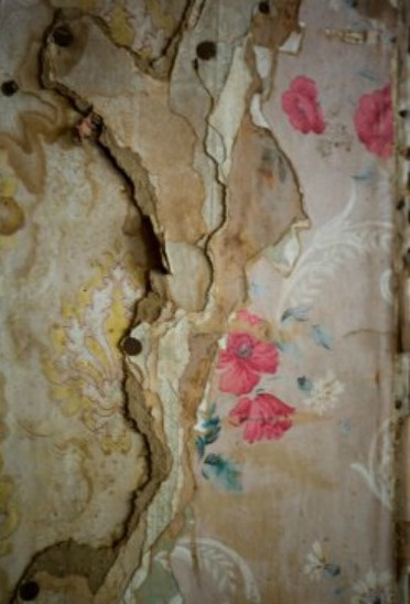 'peeling' walls in Paris restaurant ~ I have a whole wall in my house like this! 12 layers of wallpaper. I love it!