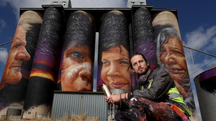 Eye for detail: Matt Adnate, with four 30m high silos he painted in the Victorian Wimmera wheat town of Sheep Hills.