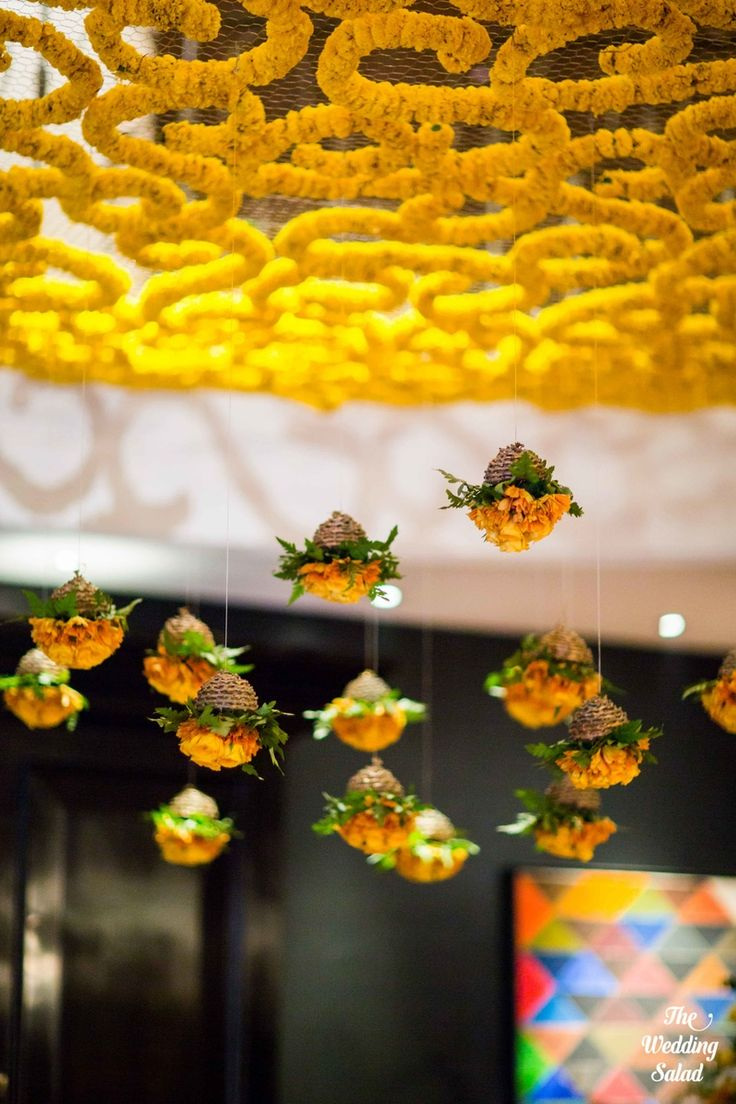 Floral hanging ceiling arrangements with suspended genda for Home decor ideas for indian wedding