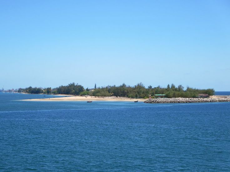 The Restinga Peninsula, a five-kilometer sandspit at Lobito, Angola, shelters Lobito Bay from the Atlantic Ocean.