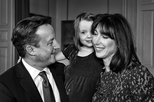 Buon Natale e Felice Anno Nuovo! To Prime Minister, First Lady, daughter Florence and the rest of the Family and team #10 Greeting: Prime Minister David Cameron and his wife Samantha photographed with daughter Florence at 10 Downing Street for their 2013 Christmas card (Florence Rose Endellion Cameron) Getty Images