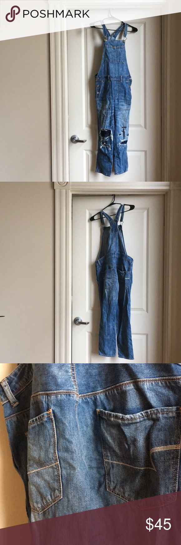 American Eagle distressed overalls Distressed patchy American Eagle overalls! Super cute denim and patches on knees American Eagle Outfitters Jeans Overalls