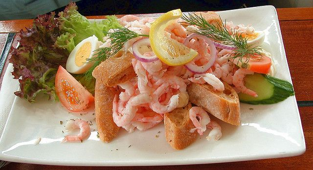 A shrimp sandwich with mayo and a slice of lemon. I used to buy this at the fishmarket in Bergen where they made it with fresh caught shrimp. SO GOOD