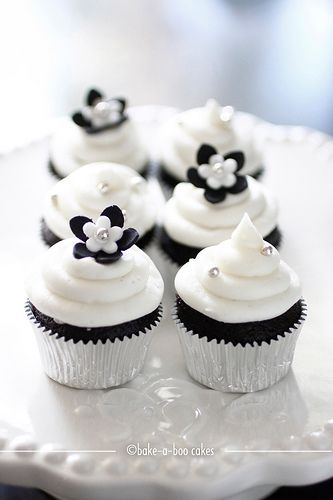 Simple black and white mini cupcakes. I would love these for the baby shower.