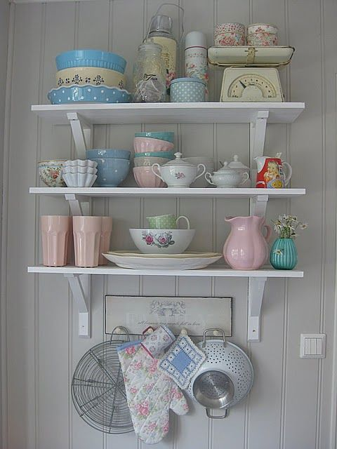 Love the white shelves with the pretty crockery