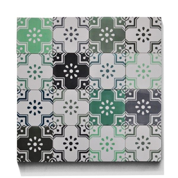 Stella goes green.   Our girl Stella is all grown up and now she stars in her very own graphic backsplash. No need to go green, Stella.     Backsplash of 16 hand decorated tiles from ARTTILES. Danish design tiles.   www.arttiles.dk