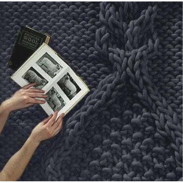 Knitted carpet designed by Christien Meindertsma