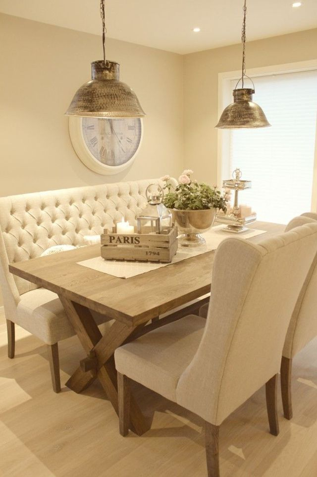 A lovely light dining space (although maybe a little impractical on the upholstery colour!) Great statement lighting.