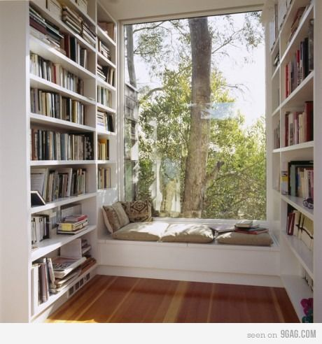 I can just imagine watching the sun come up from here while curled up with coffee and a good book!  Lovely. Maybe under stairs?