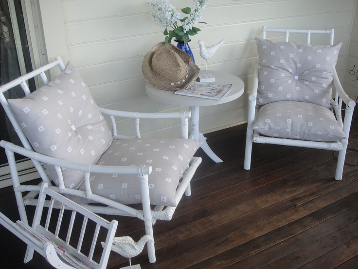 When cane furniture is in good condition it's easy and looks wonderful in white. I painted and made these cushions out of European pillows and just found some material to make the covers.  I was going to sell but it looks so great on my back veranda.