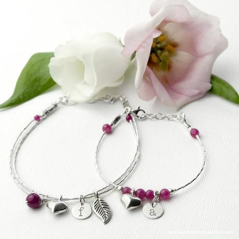 'The love between a mother and daughter is forever'.  This thoughtful and sentimental set of two personalised bracelets are a wonderful matching gift for a Mother and her Daughter. Handmade from stamped 925 sterling silver. With a delicate heart charm and semi precious Indian Ruby gemstones, the bracelet is the perfect thoughtful gift.