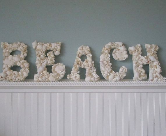 I have buckets upon buckets of seashells from my trips to the beach and I knew I would find something to use them for one day. I'm going to buy the wooden letters at a craft store and glue my seashells onto them. My bedroom is beach themed. PERFECT!!!