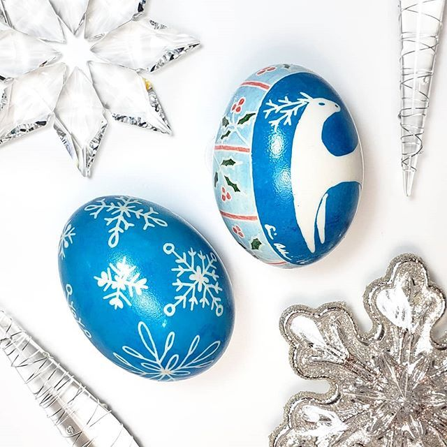 A set of eggs featuring blue snowflakes and a little deer. In Ukranian Pysanky the deer horses and rams represent Wealth and Prosperity. May your holidays be filled with those!      #deer #craft #crafts #art #artwork #egg #eggshell #xmasgifts #xmas #christmas #holiday #holidaycheer #blue #snowflakes #winter #christmasdecor #christmasgift #pysanky #pysanka