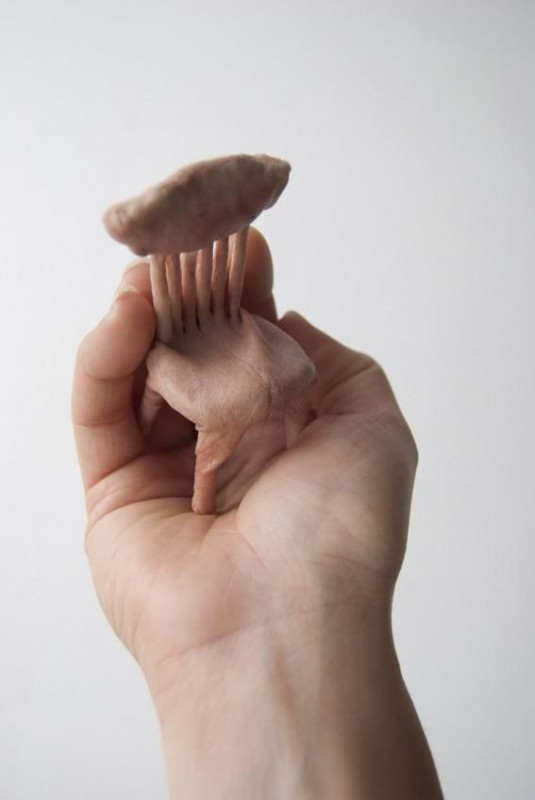 "In the unsettling sculpture series ""Handheld,"" small models of furniture appear to be made out of human skin. In actuality British artist Jessica Harrison created the sculptures using casts of her own hands.  Made of Fake Human Skin"