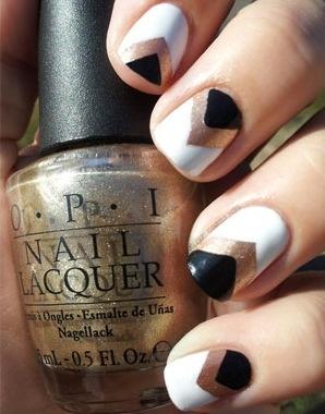 white, gold, and black chevron nails.